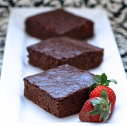 Jeanine's Decadent Brownies Recipe - Decadent brownies make a quick, easy dessert that is easy to prepare and perfect for school functions or after dinner, topped with a scoop of ice cream.