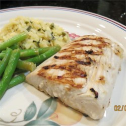 Garlic-Lemon Mahi Filets Recipe - A marinade of white Zinfandel wine, garlic, and lemon juice gives your mahi mahi fillets a nice flavor before heading to the grill.