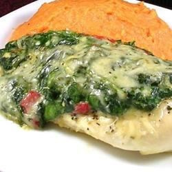 Spinach Chicken Parmesan Recipe - Parmesan-coated chicken baked in a creamy spinach sauce.