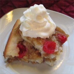 Pineapple Cobbler Recipe - Pineapple and cherries are baked in a buttery batter in this simple dessert.