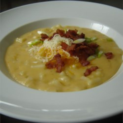 Potato Cheese Soup Recipe - Vegetable broth is the base for this wonderful soup. And yes, there are lots of potatoes. Swiss cheese is added at the last minute, so that it gently melts into this hearty soup. Very, very good.