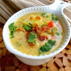 Creamy Potato Soup Recipe - Sour cream mixed with flour and paprika is used as a thickener for this potato chowder with carrots and celery.  Serve garnished with crisp crumbled bacon.