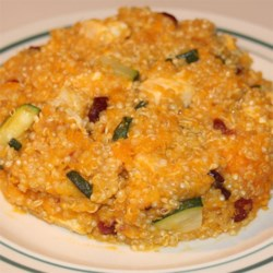 Quinoa Stuffing Recipe and Video - Quinoa, butternut squash, zucchini, cranberries, and dried apricots add flavor and color to a pilaf-like dish that's gluten-free and nice to serve as a Thanksgiving side dish or used to stuff a turkey.