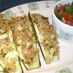 Stuffed Zucchini II Recipe - Chopped zucchini mixed with bread crumbs and herbs, and topped with a tomato salsa.  Very tasty!