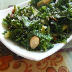 Kale with Pine Nuts and Shredded Parmesan Recipe - Kale is sauteed in butter and tossed with toasted pine nuts and shredded Parmesan cheese. Looks fancy enough for the holidays!