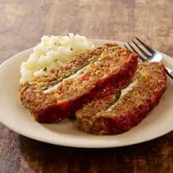 Italian Sausage Market Meatloaf Recipe - Chili sauce and Italian sausage spice up this meatloaf.
