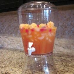 Island Punch Recipe - A great punch for any sort of celebration!  The cherries and orange slices float on top and make for a colorful presentation.