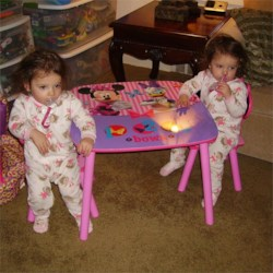 The girls w/ their new table and chairs