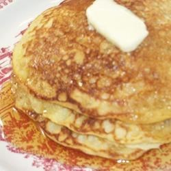 Buttermilk Oatmeal Pancakes Recipe - Cornmeal gives these hearty oatmeal pancakes a crisp texture. Serve it with berries and maple syrup.