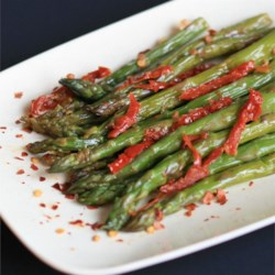 Sun-Dried Tomato Asparagus Recipe - Simmering asparagus and sun-dried tomatoes in beef broth makes a quick side dish.