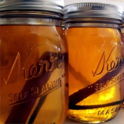 Grandma's Apple Pie 'Ala Mode' Moonshine Recipe - Apple cider and apple juice are simmered with sweeteners and seasonings to blend with grain alcohol and vanilla-flavored vodka to make a cold, apple-flavored adult beverage.
