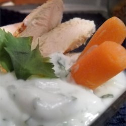 Yogurt Herb Dipping Sauce Recipe - Yogurt takes some of the caloric bite out of this creamy green dip--perfect as a potato topper or alongside fresh crudite.