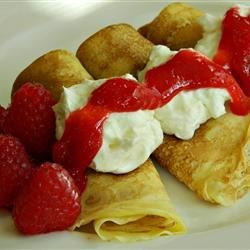 Lemon Snow Filling Recipe - Fill your favorite crepe recipe with this creamy lemon filling. Top with raspberry sauce, and garnish with fresh raspberries.