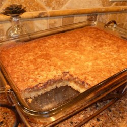 Pecan Pie Cake II Recipe - This is a dense base of cake with pecan pie filling on top.