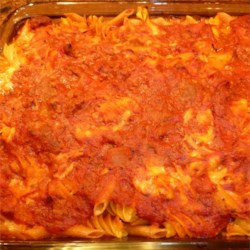 Fanny's Italian Casserole Recipe - Here's an Italian-inspired pasta and meat sauce bake that will remind you of lasagna, but it's made with macaroni, Cheddar cheese, and dressed-up purchased spaghetti sauce to make it easy to assemble.
