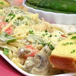 Cajun Chicken Pasta Recipe - Serve up a spicy dinner for two with this hot and creamy linguini tossed with an eye-opening blend of chicken strips sauteed with Cajun seasoning, colorful bell peppers, mushrooms and onions. Cream, basil, lemon pepper and garlic powder finish the sauce.