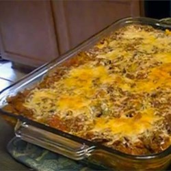 Laurel's Lasagna Recipe - A hearty blend of ground beef and pork is sauteed with onions and simmered with mushrooms, tomatoes, garlic, sugar and a medley of spices. Layered with noodles and cheeses, this earthy casserole is a crowd pleaser.