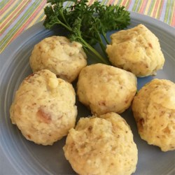 Potato Dumplings Recipe - My grandma made these.  I have carried on the tradition.  I always make more than we need.  My family loves them sliced and fried with the leftovers.  Serve with gravy. Originally submitted to ThanksgivingRecipe.com.