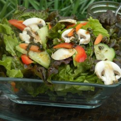 Mixed Greens with Smoked Gouda Recipe - Mixed greens are topped with marinated Gouda cheese and tomatoes in a balsamic vinaigrette. An elegant salad that can easily be prepared ahead of time.