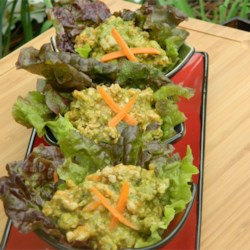 Thai Curry Pork Lettuce Wraps (Nam Prik Ong) Recipe - For this delicious and easy meal, ground pork is cooked with curry and Thai seasoning and served in crunchy lettuce leaves.
