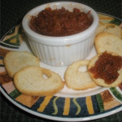 Sun-Dried Tomato Spread Recipe - Toast and bagels will never be the same once crowned with a dollop or two of this extraordinary sun-dried tomato spread. It's mildly sweet and bursting with flavor.