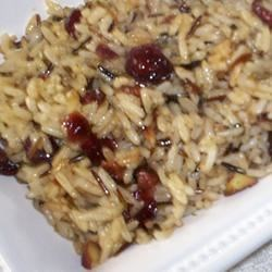 Almond Wild Rice Recipe - Made with both brown rice and wild rice, this pilaf has a hint of fruity sweetness, thanks to the addition of sweetened dried cranberries.