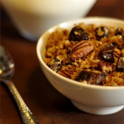 Mal's Maple Date Pecan Granola in the Slow Cooker Recipe - This easy-to-make granola is perfect for colder months and will make your house smell amazing with toasty notes of pecans, sweet maple, and spicy cinnamon. Top it off with chopped dates for added sweetness.