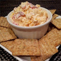 Kickin' Pimento Cheese Spread Recipe - This pimento cheese spread is great for topping burgers or serving as a dip. Add more cayenne pepper for an extra kick.