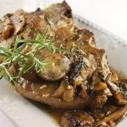Veal Chop with Portabello Mushrooms Recipe - A quick, delicious entree that is sure to impress any guest, and so easy to throw together. Veal chops and portobello mushrooms, beautifully complemented by a rosemary and red wine reduction. Serve with a side of pasta and they'll think they're in Italy.