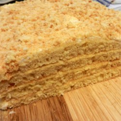 Latvian Honey Cake Recipe - A tangy sour cream and walnut filling is spread between five thin layers of honey cake.
