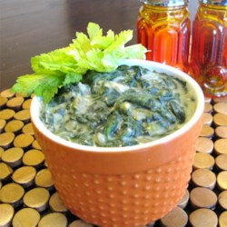 Creamy Spinach Casserole Recipe - Cream of celery soup, chopped spinach, onion and seasonings are combined in a saucepan and cooked on top of the stove in this vegetable side dish.