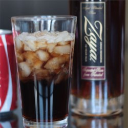 Cuba Libre Cocktail Recipe - This improved version of the simple rum and Coke includes fresh lime juice for added complexity. It's believed to have been invented in Cuba in the early 1900s.