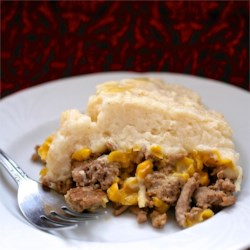 'Chinese' Pie Recipe - It's not Chinese and it's not a pie, but your family, kids included, will love this easy layered casserole of ground beef, corn, and mashed potatoes.