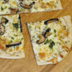 White Pizza with Porcinis Recipe - This recipe uses dried porcini mushrooms that have been rehydrated in warm water. If you can find fresh porcinis, also known as cepes and the great bolete, you should definitely use them! It's an amazing taste.