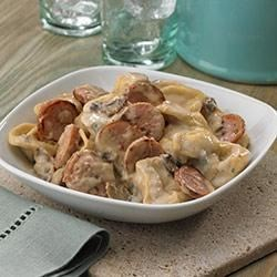 Tortellini and Sausage in Gorgonzola Cream Sauce Recipe - Sliced three-cheese Italian sausage, mushrooms, and onions are quickly pan cooked until carmelized, and are then simmered in a cheesy Alfredo sauce with cheese tortellini--a cheese lover's dream!