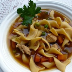 Chunky Chicken Noodle Soup Recipe - This almost-homemade soup gets a little help from store-bought chicken stock and chicken bouillon cubes, but with fresh veggies and tender chicken breasts, this noodle soup is sure to please.
