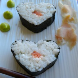 Sarah's Special Sushi Recipe - This California-style fusion sushi features untraditional but delicious smoked salmon and cream cheese rolled into nori seaweed sheets with sushi rice, then sliced into rounds.