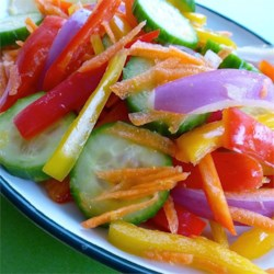 Fresh and Crisp Cucumber Salad Recipe - Fresh lemon juice and lemon zest make a simple, fresh dressing for this cucumber salad with carrot and bell pepper.