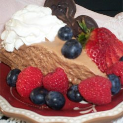 Jessica's Amazing Chocolate Mousse Pie Recipe - Light and airy chocolate mousse gets even more delicious when paired with a store-bought chocolate pie crust and a rich chocolate whipped topping.