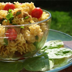 Sesame Chicken Pasta Salad Recipe - The perfect picnic pasta salad! Chopped chicken combines with toasted sesame seeds, spinach and green onions, all marinated in a sweet and tangy soy and vinegar-based dressing.