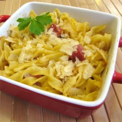 Grandma's Creamy Ham Casserole  Recipe - This creamy noodle casserole is a great way to use leftover ham. Crushed potato chips make a yummy, crunchy topping.