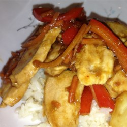 China Sun Chicken Recipe - Chicken is tossed with carrots, bell pepper, shallots, and pineapple in soy sauce and seasonings to make this sweet and savory dish.
