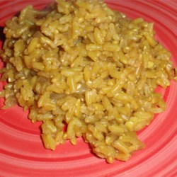 Brown Rice Curry Recipe - Turmeric gives a bright yellow color to this easy pilaf flavored with curry spices, onion, and chicken stock. It's a delicious accompaniment to fish dishes.