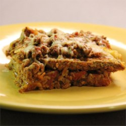 Eggplant Lasagna Recipe - This lasagna recipe replaces the traditional pasta with eggplant slices and adds layers of seasoned ground beef.