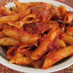 Momma's Marinara Sauce Recipe - Give a long, slow simmer to ready-made spaghetti sauce added to canned tomatoes and paste, onion, garlic and thyme. The result is a delicious marinara, suitable for your favorite pasta dishes.