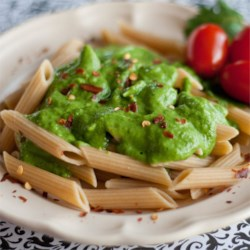 Creamy Arugula Sauce Recipe - Avocado gives this vegan green sauce a smooth and creamy texture. Fresh cilantro and lime lighten the peppery arugula and make this a wonderful topping for pasta or sandwiches.