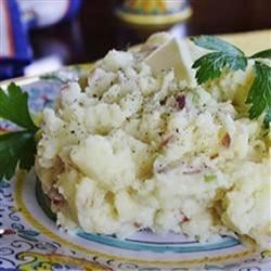 Mashed Potatoes and Buttermilk Recipe - A creamy bacon and onion mashed potato dish which is dipped into a bowl of buttermilk then eaten with a spoon.