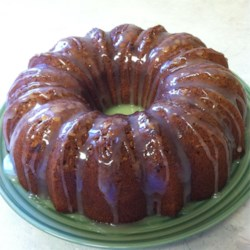 Banana Pound Cake With Caramel Glaze Recipe - A sweet caramel glaze is soaked up by this rich banana cake with pecans in every bite.