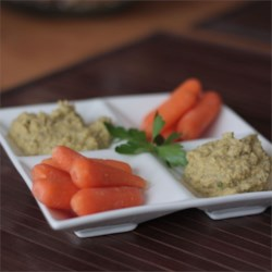 5-Minute Olive Hummus Recipe - Olives, basil, and parsley add new flavors to homemade hummus.
