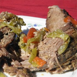 Grandma Maul's Italian Beef Recipe - Seasoned with garlic, anise, and sesame seeds, chuck roast is slowly simmered in a crock pot for a delicious Italian Beef.